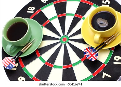 Game of a darts and coffee, in bright cups on a white background
