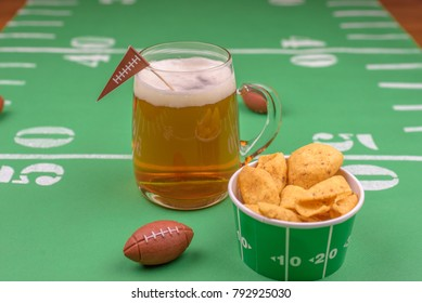 game day beer and snacks on table decorated for the superbowl