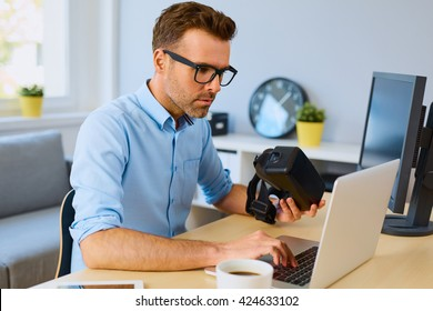 Game developer working on laptop creating VR virtual reality game