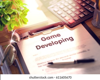 Game Developing on Clipboard. Composition with Clipboard on Working Table and Office Supplies Around. 3d Rendering. Blurred and Toned Illustration.