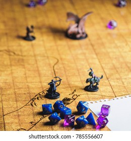 Game field of role playing party with dices and miniatures.