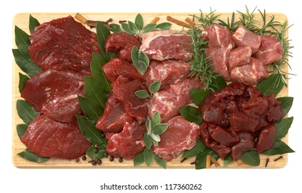 Game meat on wooden board