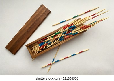 The game of mikado or shangai with the wooden sticks in the box on a table