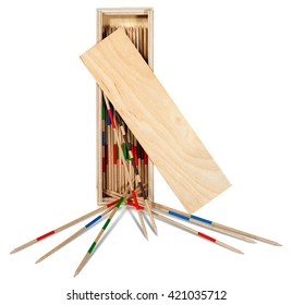 Game of mikado or shanghai with wooden sticks and box isolated on white background