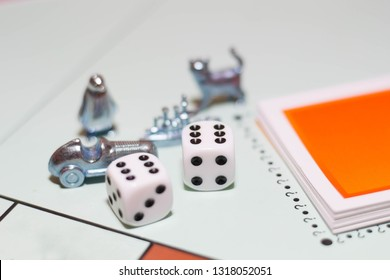 Game monopoly, game chips and dice on the table