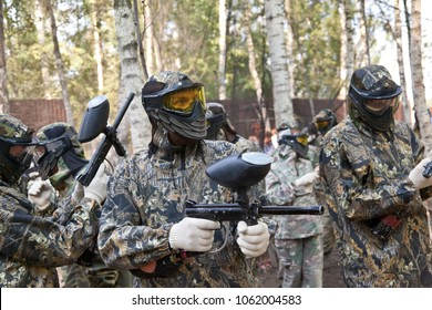 Game in a paintball. A mask for a paintball. Clothes for a game in a paintball. Team before the game.