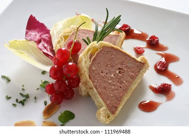 Game pate wrapped in pastry with cranberries