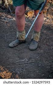 Game ranger holding rifle in the bush