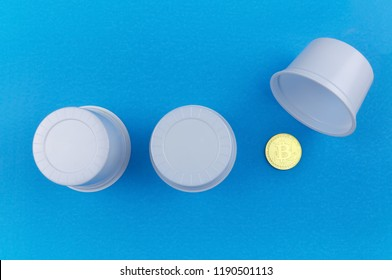 game thimbles with bitcoin on a blue background