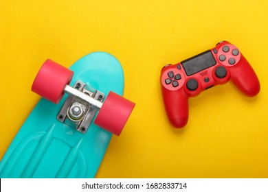 Gamepad with cruiser board on a yellow background. Childhood concept, summer fun, entertainment. Top view. Flat lay