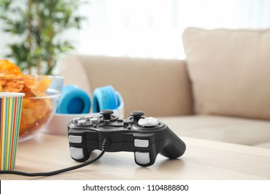 Gamepad on wooden table indoors