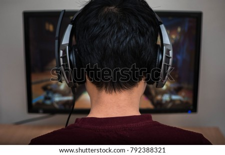 Gamer in headphone playing
