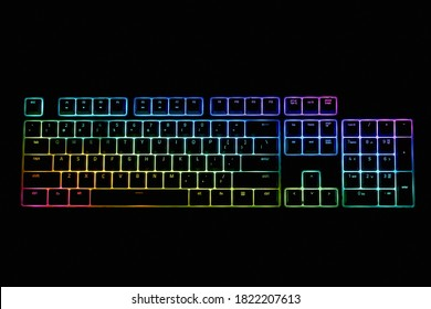 Gamer keyboard with LED backlight, top view. Multi-colored backlit keyboard.