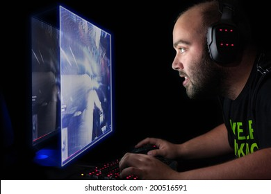 Gamer playing a first person shooter on high end pc.