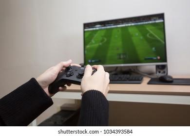gamer playing pc game wearing headphone.