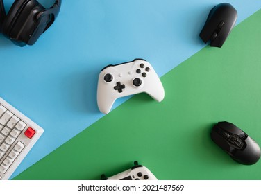 gamer work space concept, top view a gaming gear, mouse, keyboard, joystick, headset.