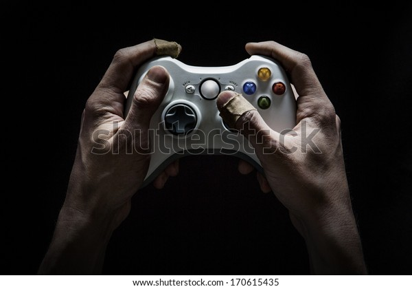 Gaming Addict - Dirty and damaged hands worn from playing too many computer/video games.