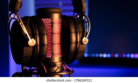 Gaming headphones with microphone and neon illumination diodes. Gaming devices, neon lights. Game zone.