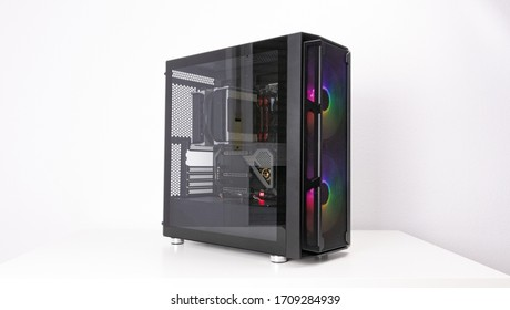 Gaming PC with RGB LED lights and big fans on the front. Computer assembled with hardware components