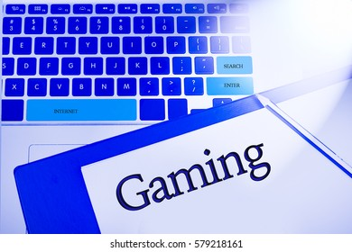 GAMING  word in business concepts, technology background in laptop and notepad