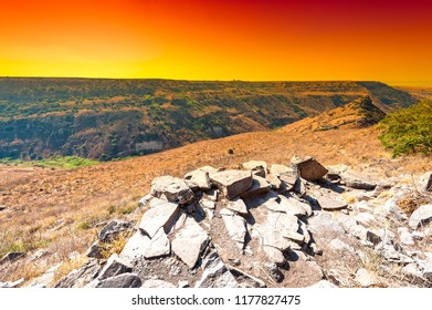 Gamla nature reserve located in the Golan Heights in Israel at sunrise. View of the archaeological sites and sea of Galilee