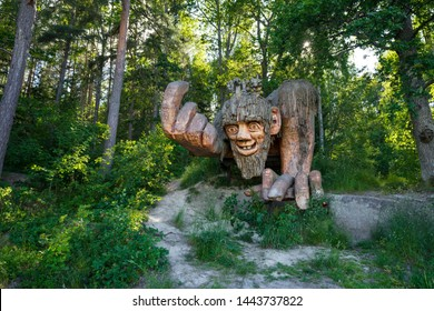 Gamleby / Sweden - June 22 2019: Troll Forest park at Garpedansberget. Artist Jerzy Przybyl aka Jan Pol has created the sculpture park along rock wall depicting figures derived from local mythology.