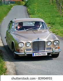 "GAMLITZ, AUSTRIA - APRIL 30: An unidentified driver in a 1967 Jaguar 420 participates in a rally for vintage cars ""Suedsteiermark Classic"" on April 30, 2011 in Gamlitz, Austria."