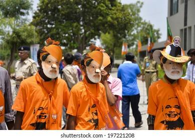 GANDHINAGAR, GUJARAT/INDIA - MAY FRIDAY 16 : Three boys wearing mask of Narendra Modi on 16 May in BJP office Gandhinagar, India.
