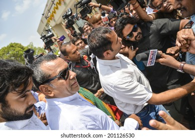 GANDHINAGAR, GUJARAT/INDIA - MAY FRIDAY 16TH 2014 : BJP candidate and actor Paresh Rawal who won from Ahmedabad East with his wife in Gandhinagar, BJP office in India.