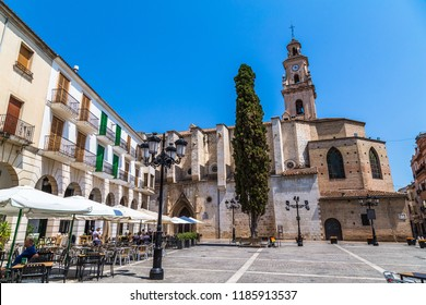 Gandia, Spain, July 2018: Gandia's main square with its Collegiate church of Santa María de Gandía, in Gothic style, built in 1499 and restored in 1999, declared a National Historic Landmark.