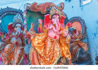 Ganesh Chaturthi,a famous hindu festival in india where big molds of god ganesha made in Bengali culture style and sold. with selective focus on subject pillaiyar Ganapati Binayak golu Navaratri