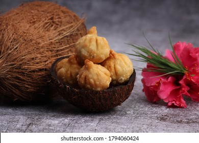 Ganesh Puja - Sweet Modak food offered on Ganpati festival or Chaturthi in India. served in coconut shell with coconut.
