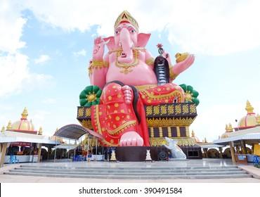 Ganesh sitting on a throne behind the sky