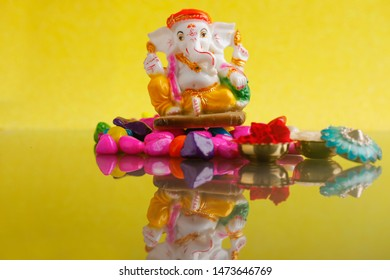 Ganesha Festival, Lord Ganesha statue on colorful little stone