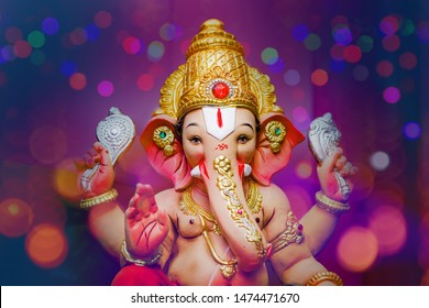 Ganesha Festival, Lord Ganesha statue on colorful background