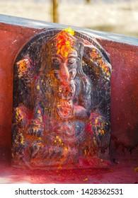 Ganesha Hindu deities shrine with vermillion red pigment powder at Kali Temple, in Dhulikhel, Nepal