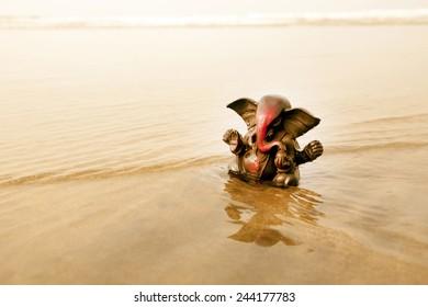 Ganesha on the tropical beach.