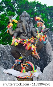 Ganesha statue with multicolor ribbons at the top of the Wat Tham Sua in Krabi