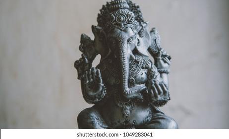 Ganesha statuette close-up.