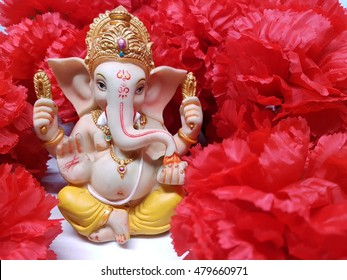Ganesha,Hindu God and the god of success, Lord Ganesha with red flowers background.
