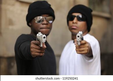 Gang members on the street, focus on guns