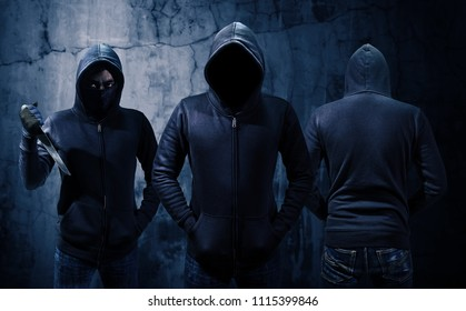 Gang of robbers or burglars dressed in black