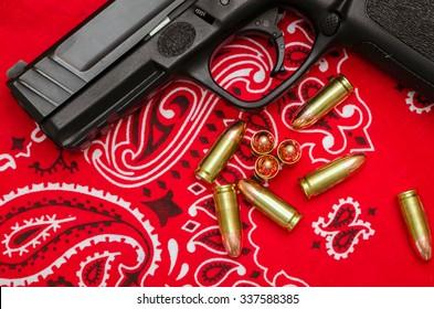Gang Violence Concept - Bullets and Gun on Bandana Symbolizing Inner City Social Issues