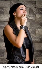 gang woman smokes on the street, selective focus