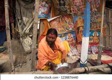 GANGASAGAR, INDIA 14 JANUARY 2018 : Unidentified Hindu Sadhu the holy man  holy white ash applied on body and face, Came for blessing Indian devotee people at Gangasagar.