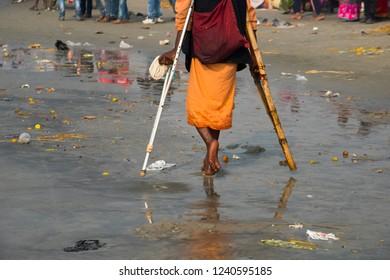GANGASAGAR, INDIA 14 JANUARY 2018 : An unidentified Hindu pilgrim takes a holy dip in Ganges on the day of 'Makar Sankranti' in Gangasagar Islands, West Bengal,India.