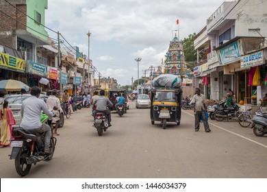 Gangavathi / India - July 8 2019: A view of a street in a smaller south Indian city on a cloudy summer afternoon.