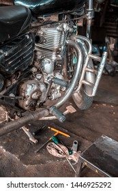 Gangavathi / India - July 8 2019: A old motorcycle being repaired in a workshop in south India.