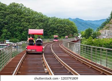 Gangchon Rail Park, Chuncheon, Korea - June 10, 2018: Happy tourist and enjoy the nature scene while pedal along old railroad tracks in Gangchon Rail Park in Chuncheon in South Korea.