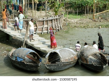 Ganges Delta / Bangladesh - Feb 16 2006: Fishing boats moored at the side of the river in a small town. Waterways of the Ganges Delta in southern Bangladesh.